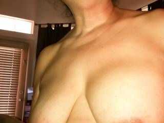A post-blowjob topless photo with my mouth full of cum that I couldn't quite contain, as you can see from the cum on my lips and cum dripping down my chin and body.  Yes, it tasted delicious!