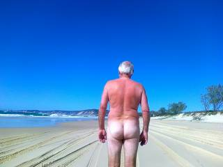 nice ass... beautiful beach--wish i was there to enjoy the nudity! i'd spank you, but you'd have to return the favor! hard!