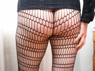 New fishnet, no panties, ready to go out tonight ... the pussy already wet.