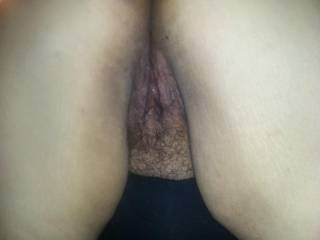 Wife bent over showing her hairy pussy