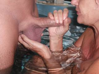 Playing with my Hubby's lovely big smooth thick cock and balls in the spa at home.