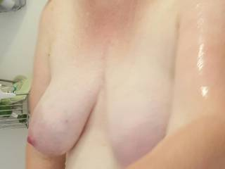 Heavy milk filled tits getting clean in the shower