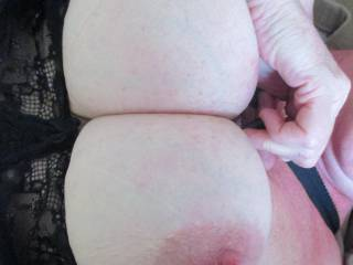 Rubbing his cock all over my tits and nipples