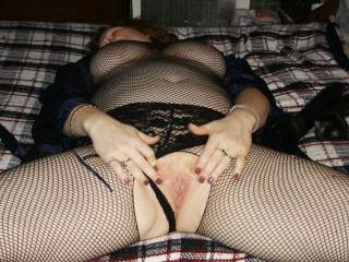 Another shot of my wifes pussy.  She loves her fishnet body suit.  She is a true redhead.