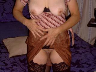 She looks very sexy in her skirt and stockings. I would love to have her grind that smooth shaved pussy against my face while I lick her folds and suck on her lips.