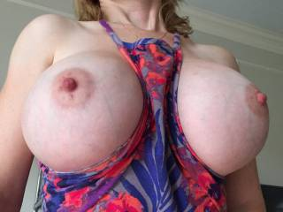 I certainly do love that dress, it fits perfectly and shows those magnificent tits off in a superb way !