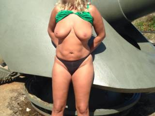 Verrrry sexy body & tits.  Love outdoor flashing type pics, as well as skimpy bikinis {or bikin style pants} & especially with top off or lifted like this.  This is a huge turn on pic for me for all those reasons