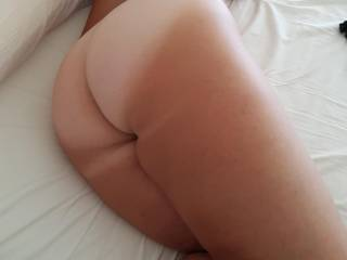 Me on the bed with my big bum exposed. What you do? Would you like to spread it and see my asshole?