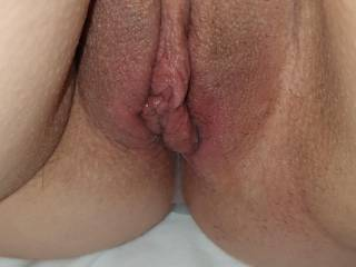 Shaved pussy with cum
