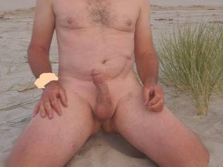 Having my photo taken on the beach. Enjoying the Sun and the scenery. Anyone care to join me?