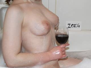 wow , can I suck those beautiful tities please.. and that wine looks great too