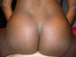 after I let her cream on my dick, I'd cum all over her sexy black ass!