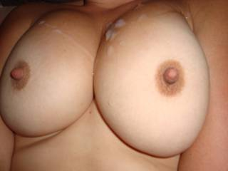 Wow! Amazing tits! They need a bigger load than that!