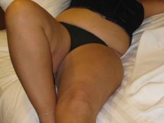 laying back in corset and panties