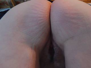 I sat for a while sucking our neighbors cock.. then he told me to bend over..Just about ready to take his big cock.. do you like my ass?