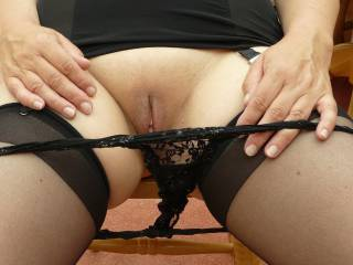 Basque, lacy knickers (on here way down!) and stockings.