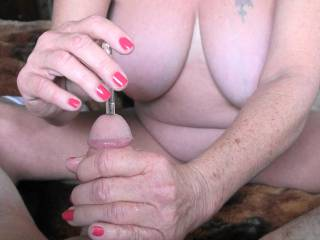 1 of 4 photos showing me pushing  new sex toy, a glass rod into my boyfriends cock. It is about 9 inches long and about 8mm wide. In this photo I have it in more than half way, he just loves the feel of it, would you like to try this?