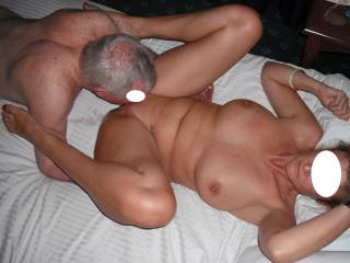 Our swinger friend is very skilful at eating out my pussy.  You can see he is pushing all the right buttons judging from my look!