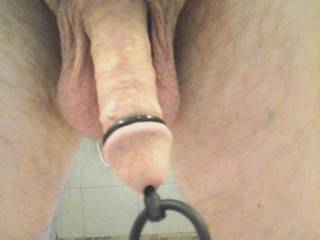 His soft dick getting in the shower after being naked, playing and wearing this plug all day.