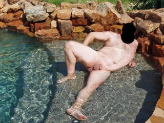 I took away hubby's swim trunks and made him pose nude for me in our pool!