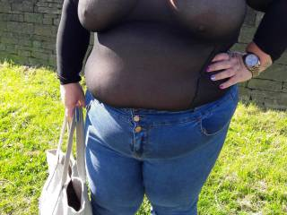 Out for a walk in her sheer top