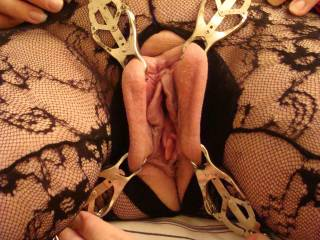 two sets of clovert clips pulling her pussy open