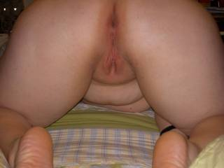 Love to rub my cock on her ass and feet then poke it inher asshole until I am ready to cum.  Then i'd cover her cute feet in Jizz.