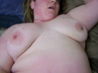 wifes tits as i fuck her.