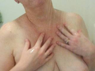 Heavy milk filled lactating tits in the shower