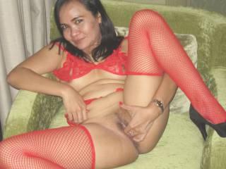 Candy in Jakarta posing in red fishnet...