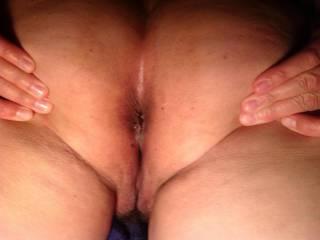 Spreading her sweet ass :)