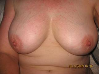 I can see they're already big and heavy... I can imagine just how warm and soft they would feel in my hands as I massage them, licking, sucking and biting the nipples xx
