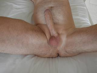 legs wide open for perfect view of my bold genitals. Big fat cock; don't you agree?