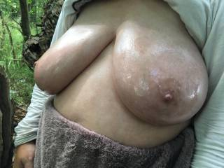 A view from the front left, glancing across at the lovely oiled large tits of my lovely friend