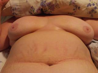 just took a breather to from eating pussy to snap this pic. the wife says the only thing that would make this better is if there was another woman there to suck on her tits while i play with her pussy. any takers out there???