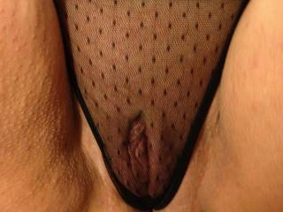 Close up of her freshly shaved pussy in those sheer panties