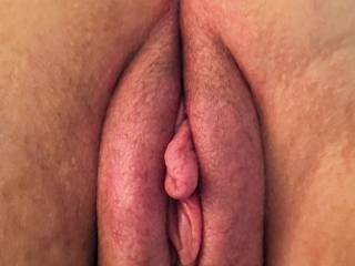 rear view of pumped pussy, her inner lip protruding and waiting to be sucked
