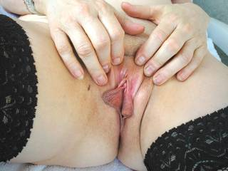 She had just finished masturbating and is showing off her engorged labia and clitoris and she is dripping wet from arousal