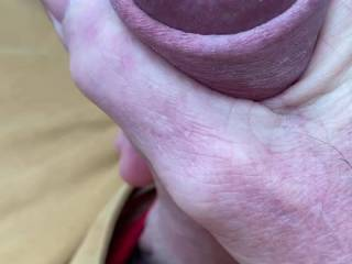 Stroking and squeezing out the precum