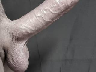 Does he look angry? All those ridges prominent on the rock hard shaft. Angled upward so high, rigid and raging to be pumped into a tight, hot, wet pussy. YES he\'s angry!