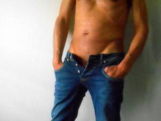 Mmmm great start.  I really love a man in jeans with his manhood begging to be free  l, then I place my hand in them and release  his growing cock for  some fun. :) Pleasure