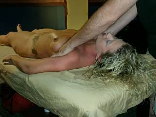 Here she is enjoying a naked massage at the club.  Yes.. There was a line. :)