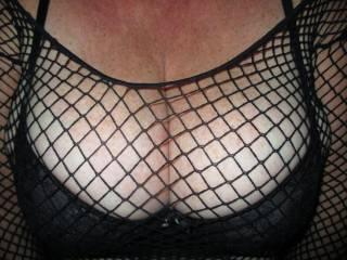 In my fishnet top.