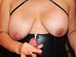 I put his steel cock ring on him and I'm now stroking his hard cock slowly and with purpose…I'm looking for multiple, large, fabulous cumshots!