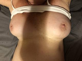 She's telling me it's time to kiss and suck on her nice tits.