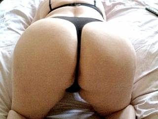 I wish I was behind you I would spread ur ass and legs as I rub the head of my hard dick up and down trying to pushing ur thong over with my dick teasing both ur ass and pussy before letting you feel just the head sliding in ....