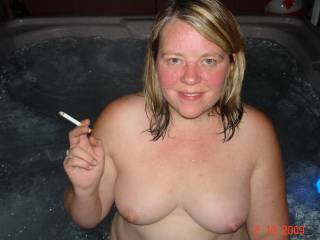 my wife in our hot tub nude