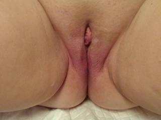 I decided to take a series of pictures of Mrs. Truck's Pussy to show how her clit gets progressively more swollen as I suck on it and play with it. This is picture 1 as we begin. We are looking for other local couples to play with and others to share with