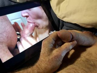 Watching a sexy blowjob video and loving it.