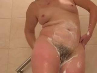 My sexy wife cleaning her pussy. I love seeing her tits jiggle!